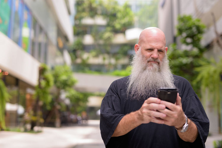 Man using mobile phone outdoors