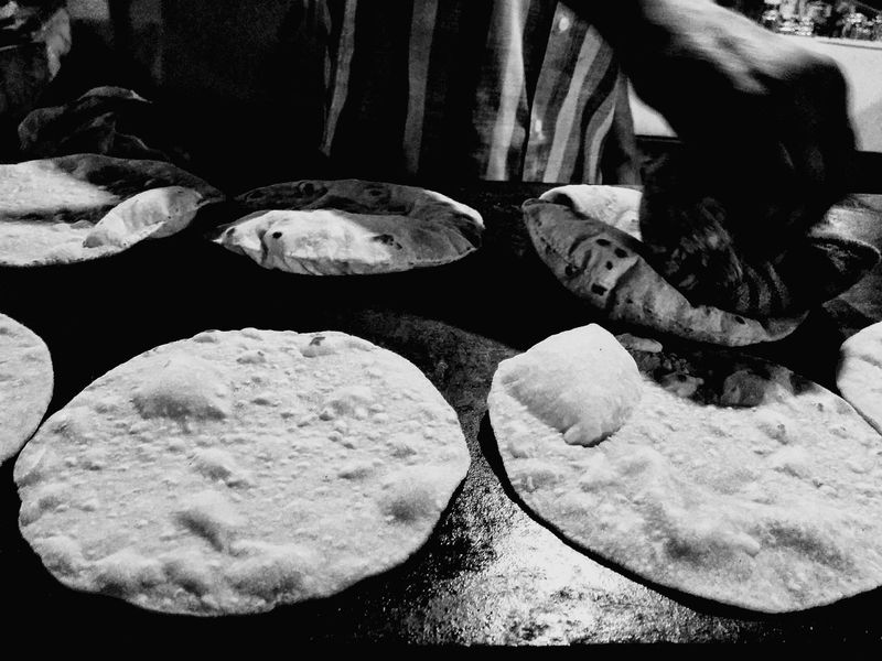 The OO Mission Breads Indian Roti Eyeem Streetphotography Streatphotograpy Making Bread Hanging Out People Nightphotography Blackandwhite Photography Eyeem Mission Shootermag Nexus5photography Mobilephotography June Showcase