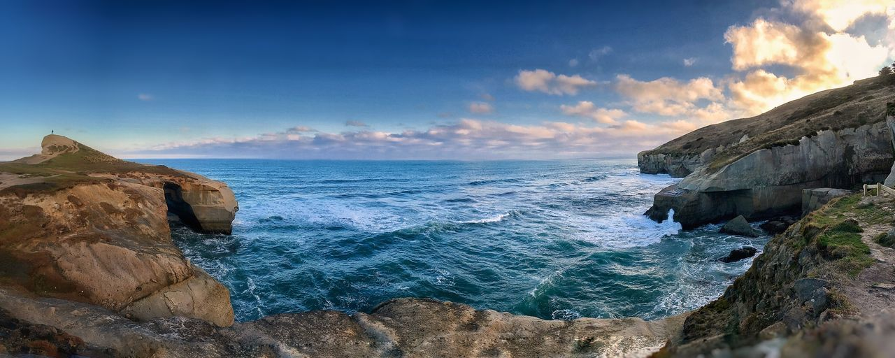 Beyond tunnel beach Panorama One Person In The Distance Deep Rugged Coastline Dusk Clouds Ocean Waves Cliffs Sea Water Sky