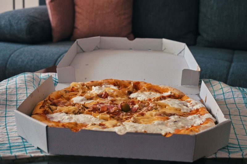 Close-up of pizza on table at home