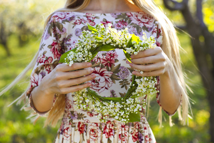 Close-up of woman holding flowering plants