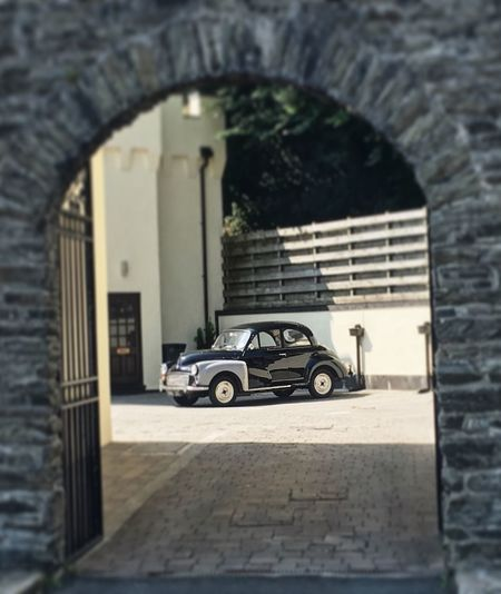Architecture Built Structure Arch Building Building Exterior Mode Of Transportation Day Transportation Outdoors Land Vehicle No People Selective Focus Car Wall - Building Feature Wall Window Nature Entrance The Past Morris Morrisminor