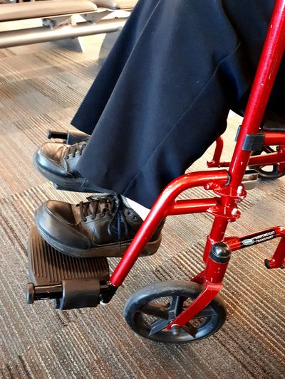 Red Wheels Caring For A Senior Senior Adult Transport Chair Disability  Disability Awareness Disability Awareness Week Cerebral Palsy Preboarding Blue Pants  Assistance Before Flight Nursing Care Nursing Home The Street Photographer - 2017 EyeEm Awards Wheelchair Access Wheelchair Fire Engine Red Out Of The Box Let's Go. Together. EyeEm Selects