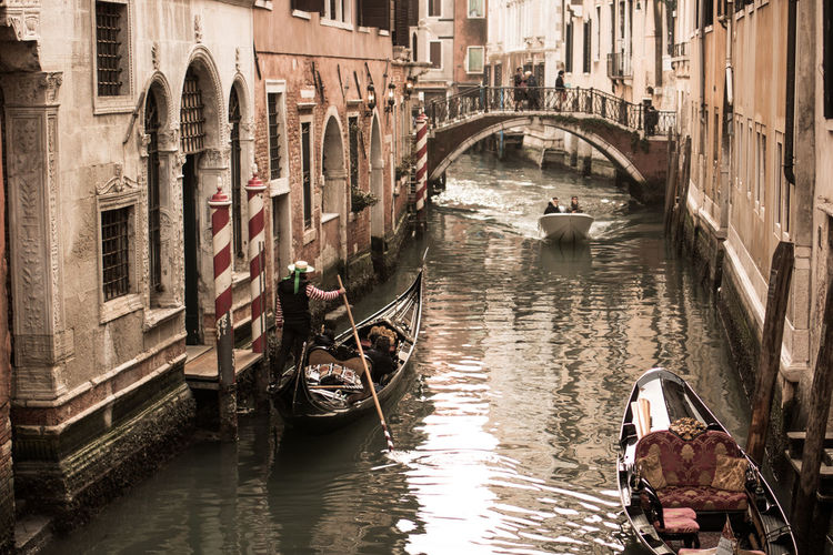 Venice canals scene Venice Italy Holiday EyeEm Best Shots EyeEm Selects Gondola - Traditional Boat City Water Nautical Vessel Bridge - Man Made Structure Gondolier Canal Architecture Building Exterior Built Structure Old Town Bridge