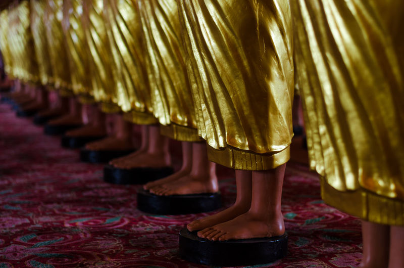 statue gold bhudha Bhudha Statue Adult Art Art And Craft Arts Culture And Entertainment Body Part Close-up Focus On Foreground Gold Colored Group Of People Human Body Part Human Foot Human Leg In A Row Indoors  Low Section People Real People Selective Focus Shoe Temple Women