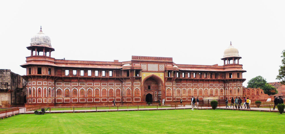Architectural Feature Architecture Building Exterior Built Structure Capital Cities  City Clear Sky Day Dome Exterior Façade Famous Place Grass Green Color History India Lawn No People Outdoors Red Fort Sky Tourism Travel Destinations