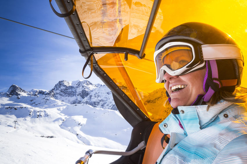 Portait of woman in chairlift Austria Bavaria Chair Chairlift Enjoying Life Fun Glacier Ischgl Lift Montafon Mountain One Person Outdoors Silvretta Ski Goggles Ski Holiday Ski Resort  Snow Stubai Sun Tux Vacations Winter Woman Zugspitze