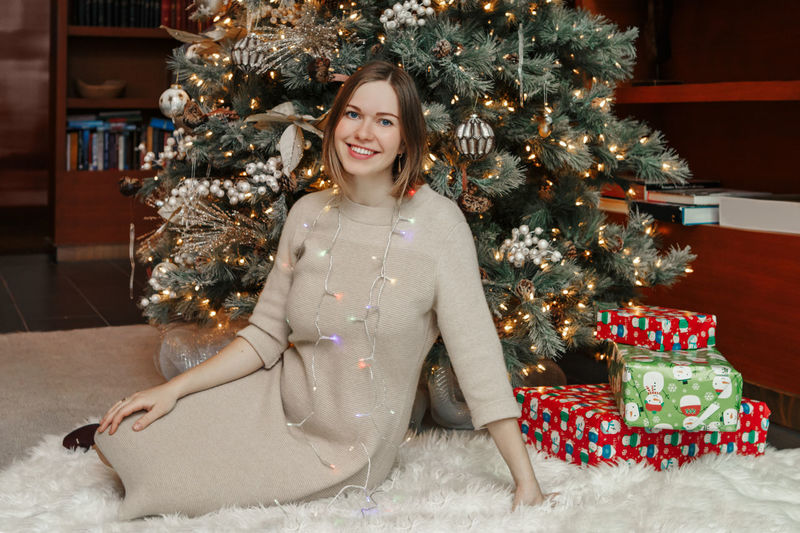 Portrait of woman with christmas tree