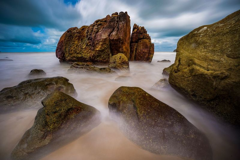 Long Exposure shot of a stony Beach in Kuching, Sarawak Water Sky Sea Cloud - Sky Beauty In Nature Land Scenics - Nature Rock - Object Rock Nature Solid Beach No People Motion Tranquility Outdoors Tranquil Scene Long Exposure Rock Formation Power In Nature