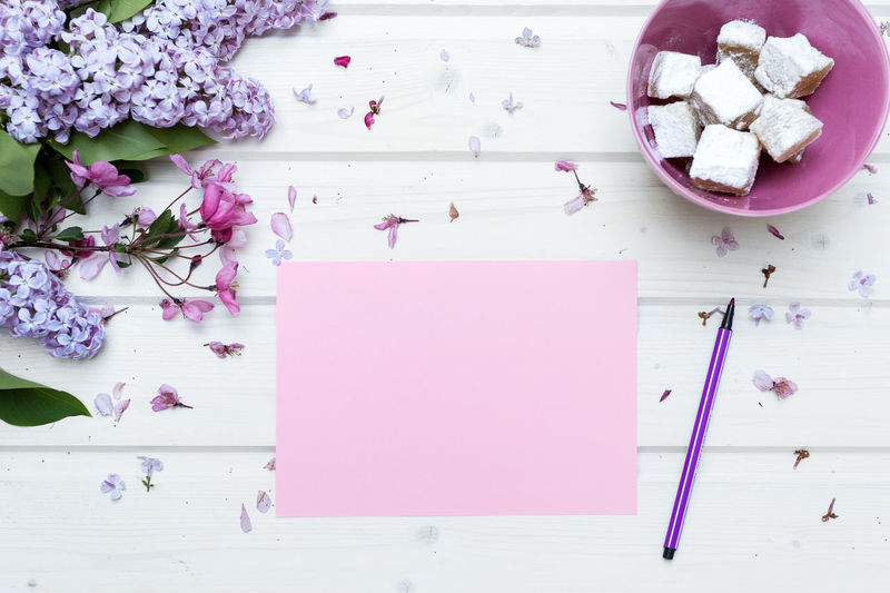 White tabletop scene with a blank pink paper Blank Pink Paper Blank Space Blooming Flower Freshness High Angle View Image For Bloggers Istock Styled Photo Lifestyles Mock Up Mockup Scene No People Paper Pen Pink Color Pink Colors Ship Deck Tabletop Social Media Spring Flowers Stock Photo Styled Stock Photos Table Tabletop Scene View From Above Water