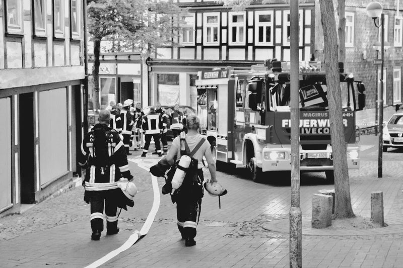 Doing their duty. Full Length Real People Street Building Exterior Lifestyles Built Structure Outdoors Architecture Men City Day Large Group Of People Adult People Firefighters Fire Truck Fire Department Feuerwehr Firefighters In Action