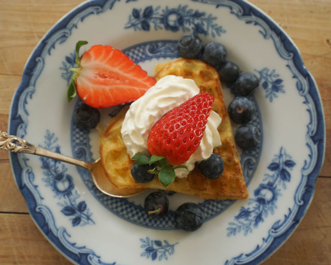 waffle heart with fresh berries and wipped cream Waffel Waffle Sweet Food Berry Fruit Berry Berries Strawberry Blueberry Directly Above Close-up Norwegian Waffle Plate Comfort Food Seafood Close-up Food And Drink Whipped Cream Cream Dessert Topping