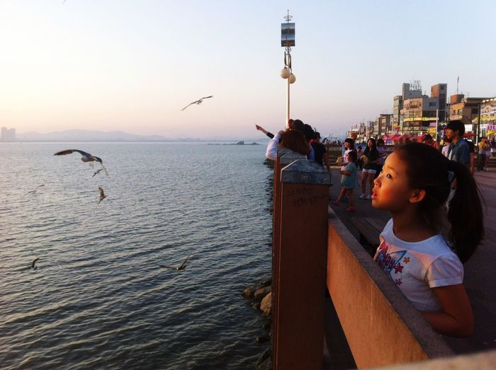 EyeEm Selects Water Real People Sky One Person Lifestyles Leisure Activity Bird Sea Sunset Looking