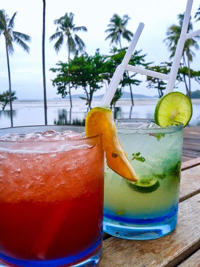Refreshing Cool Fress Relaxing Backgrounds Beach Sea Juice Soda Water Lemon Orange Cocktail Household Equipment Fruit Healthy Eating Alcohol Freshness No People Straw Drinking Straw Table Citrus Fruit Cold Temperature Wellbeing SLICE