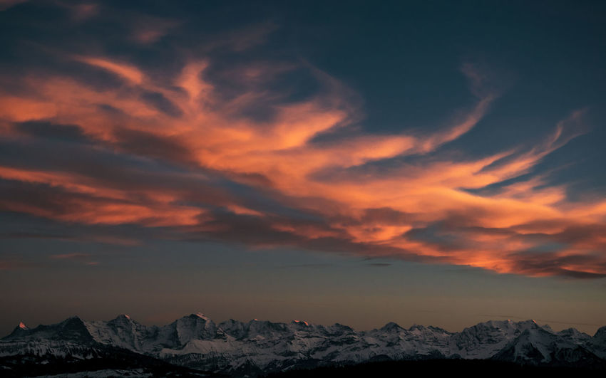 Afterglow Dramatic Sky Majestic Nature The Week On EyeEm Beauty In Nature Cloud - Sky Evening Sky Landscape Majestic Mountain Mountain Range Natural Phenomenon Night Orange Color Scenics Sky Sunset Swiss Alps Vibrant Color Vibrant Colours Shades Of Winter