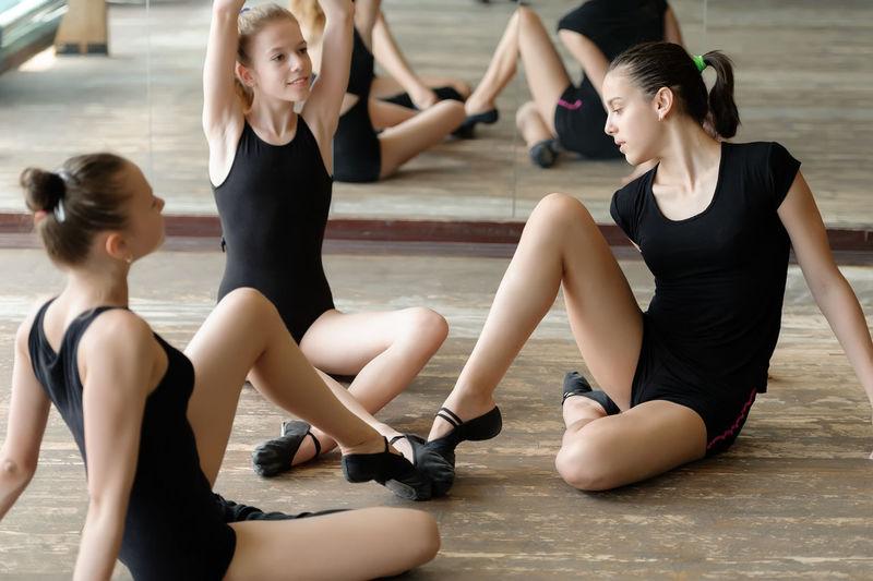 Ballerina Ballet Ballet-girl Caucasian Dance Dance-hall Dancer Floor Girl Mirror Practice Rehearse Room Sit Stretch Student Three Women Young Women