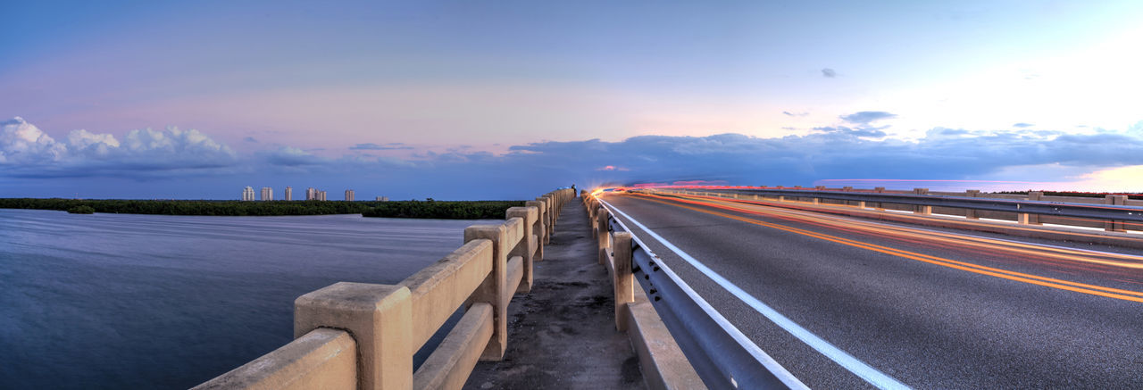 Panoramic view of highway against sky during sunset