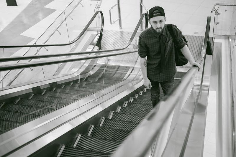 High angle portrait of young man on escalator