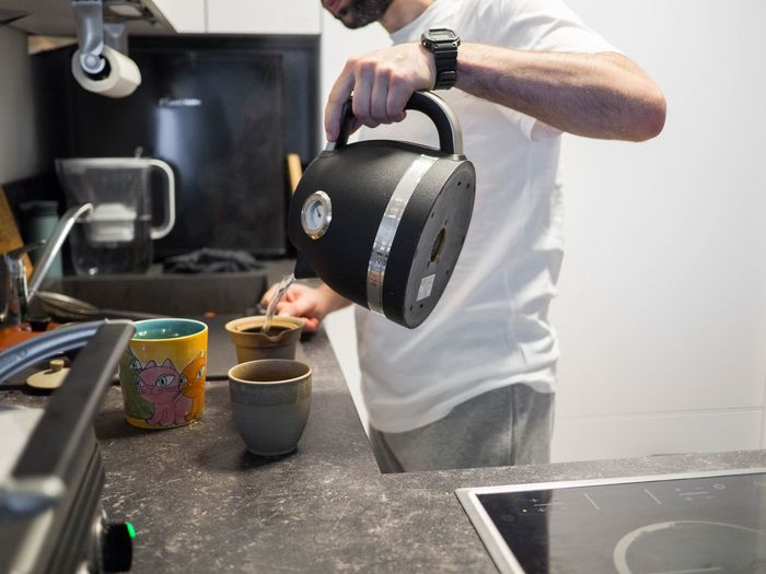 Man holding coffee cup at home