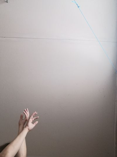 Low section of woman against white wall