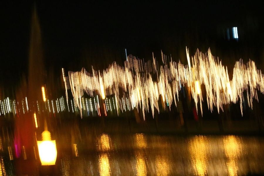 Blurredbackground Blurred Motion Outdoors Night Illuminated Glowing Firework Display Exploding Arts Culture And Entertainment Celebration Long Exposure Event No People Sparks Firework - Man Made Object Motion Multi Colored City Architecture Sky Firework Blurred Background Blurred Lights Motion Blur