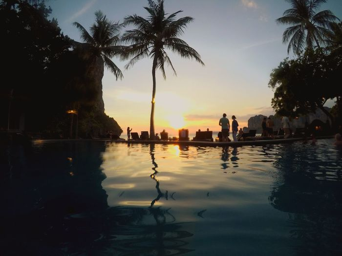 Feeling blessed by the last sunset on vacation Sunset Sun Peace Swimming Pool Thailand Lastsunset Railey Beach Water Tree Sky Plant Reflection Sunset My Best Travel Photo