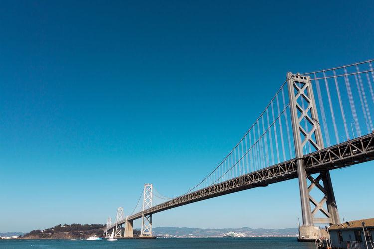 Low angle view of bay bridge over san francisco bay