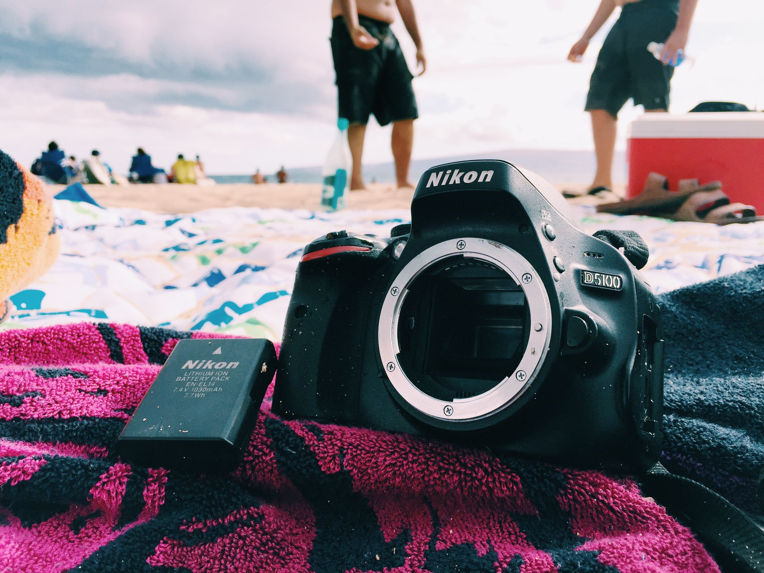 low section, person, lifestyles, leisure activity, men, standing, beach, part of, midsection, human foot, shoe, sea, unrecognizable person, casual clothing, focus on foreground