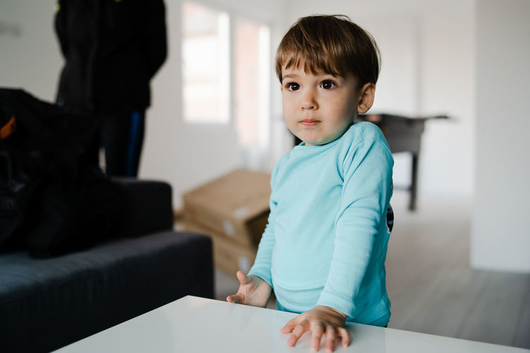 Indoors  Child Childhood Focus On Foreground Sitting Casual Clothing Innocence Men Males  Women Home Interior Domestic Room Boys Females Portrait Lifestyles Real People People Front View Table My Best Photo