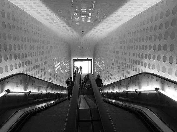 Real People Illuminated Indoors  Architecture Modern Built Structure Transportation Railing Light And Shadow Reflection Travel Tourism City Hamburg Elbphilharmonie Steps And Staircases Staircase Modern Architecture The Way Forward Monochrome Bnw Black & White Blackandwhite Photography Black And White Architecture