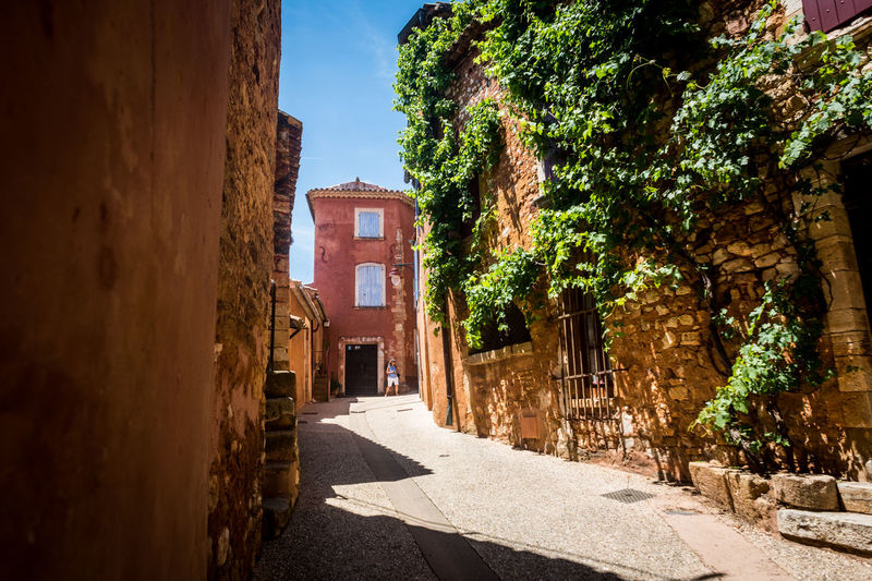 Alley Architecture Building Building Exterior Built Structure City Day Direction House Nature No People Outdoors Plant Residential District Road Street Sunlight The Way Forward Town Tree Window