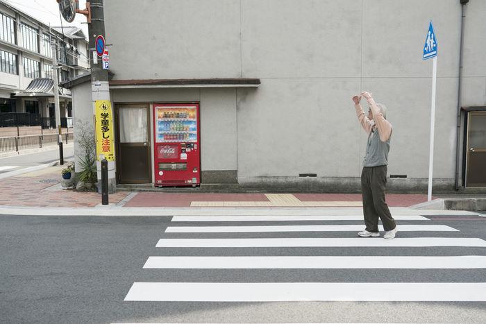 MAN CROSSING ROAD
