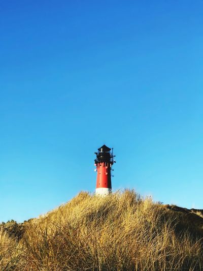 Winter Northsea Sky Blue Copy Space Clear Sky Low Angle View Tower Security Built Structure Sunlight Building Plant No People Guidance Architecture Lighthouse Building Exterior Day Nature Protection Safety