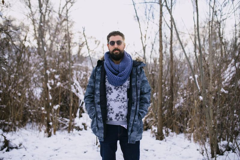 Winter Snow Cold Temperature Tree Clothing One Person Land Plant Young Adult Front View Young Men Portrait Standing Non-urban Scene Nature Warm Clothing Forest Day Scarf Outdoors