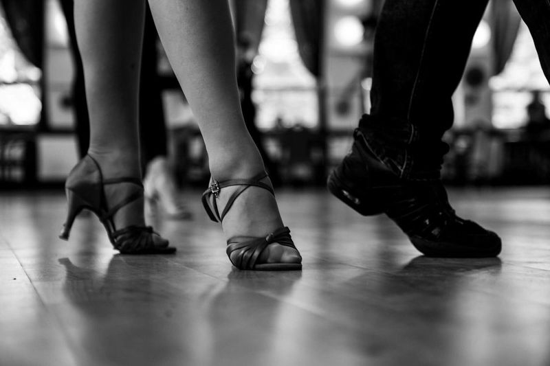 Low Section Human Leg Indoors  Dancing Performance Arts Culture And Entertainment Women Real People Two People Ballet Skill  Human Body Part Ballet Dancer Dancer Togetherness Focus On Foreground Ballet Studio Practicing Standing Stage - Performance Space Ballroomdancing Latin