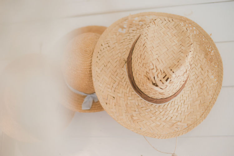 Close-up Straw Hat Hat Still Life Indoors  Basket Wicker No People Sun Hat Pattern Clothing Container High Angle View Beige Table Headwear Security Wood - Material Hanging Flooring Personal Accessory