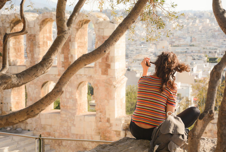 On the side of Acropolis, this lonely girl was just enjoying the atmosphere ...Acropolis, Athens Chilling Out Curly Hair Girl One Person One Woman Only One Young Woman Only People Plait Snap a Stranger Sunlight Travel Destinations Travel Photography Traveling Tree Young Adult Finding New Frontiers The City Light Women Around The World Connected By Travel Lost In The Landscape Be. Ready. EyeEm Ready   An Eye For Travel Love Yourself Colour Your Horizn Stories From The City Go Higher Summer Exploratorium Focus On The Story Adventures In The City Creative Space Summer Sports Summer In The City #urbanana: The Urban Playground Be Brave A New Beginning Autumn Mood