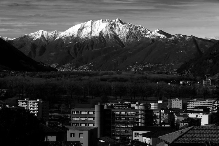 Architecture Beauty In Nature Blackandwhite Building Exterior Buildings Cityscape Cloud - Sky Day EyeEm Nature Lover High Angle View Landscape Majestic Monochrome Mountain Mountain Range Nature No People Outdoors Scenics Sky Snow Snowcapped Mountain Tranquility Travel Destinations Valley