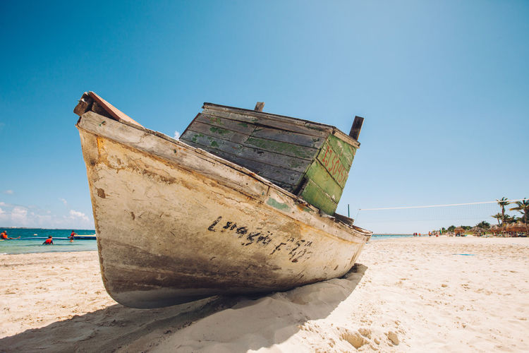 Little old cuban boat by a mexican beach Adventure Boat Clear Sky Dramatic Angles Mode Of Transport Nautical Vessel Sand Sea Ship Shore Tranquil Scene Transportation Vacations Water