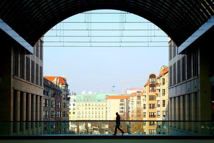 Man Walking By Railing In Building