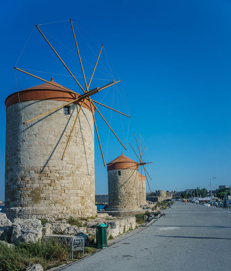 Traditional windmill against blue sky