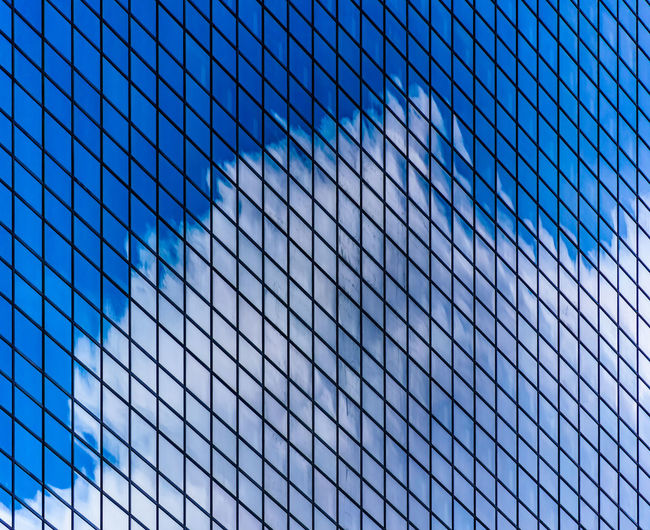 Cloud reflection on an office building glass facade Architecture Pattern No People Blue Sky Full Frame Backgrounds Building Exterior Modern Glass - Material Cloud - Sky Day Building Design Nature City Reflection Abstract Outdoors Office Building Exterior Abstract Backgrounds Steel Contrast Environment Urbanization