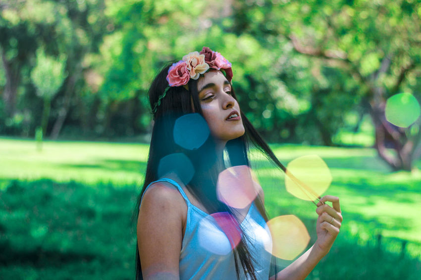 #portrait #photography #bubbles #bokeh #nature #flowers #girl #indian #headband One Person People Portrait Fun Outdoors Happiness Long Hair Nature Smiling Tree Grass Summer