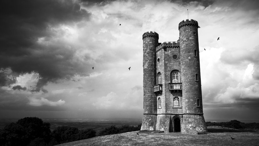 Broadway tower against cloudy sky