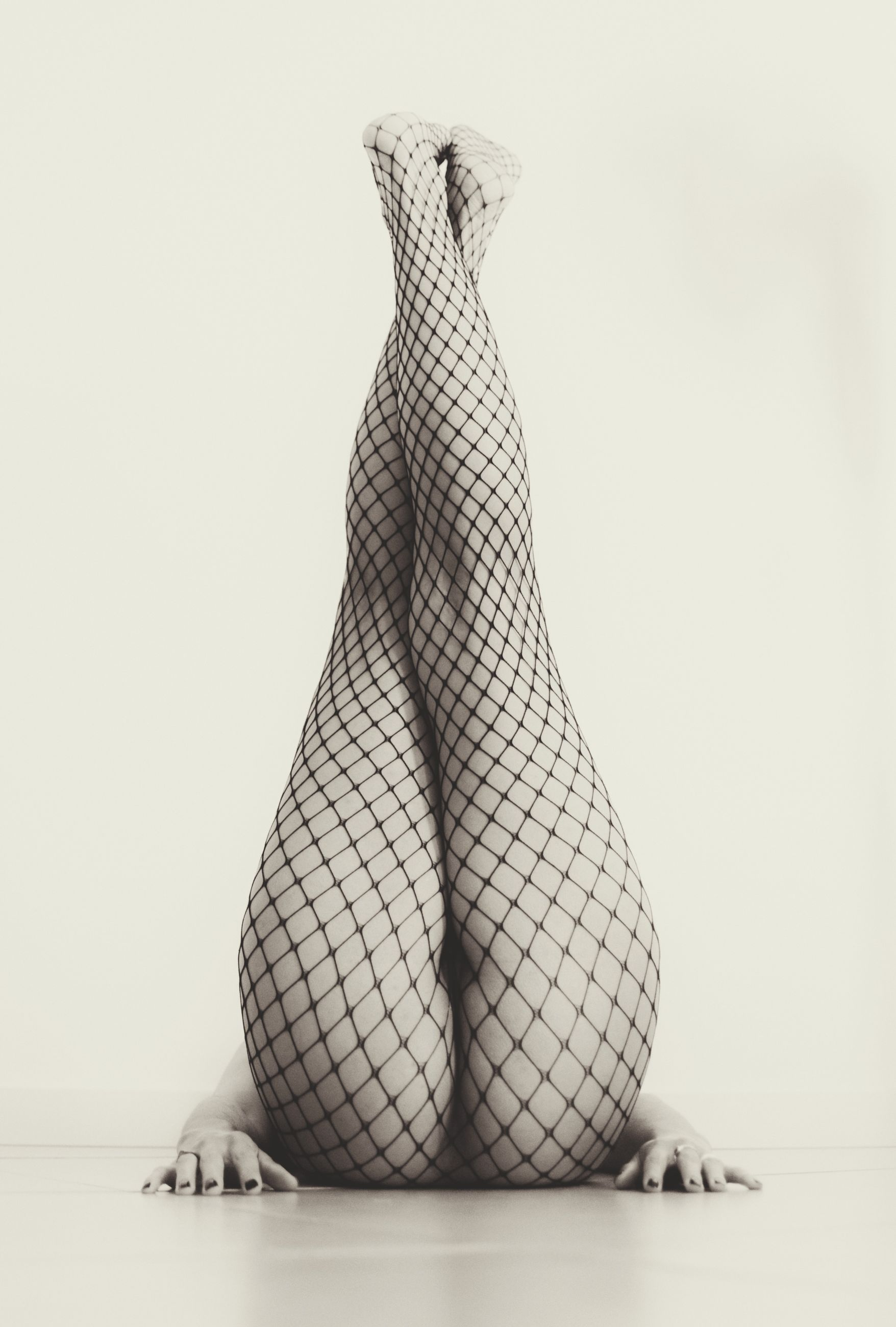 studio shot, one person, indoors, low section, white background, human leg, body part, females, women, human body part, barefoot, fashion, copy space, adult, clothing, stockings, lifestyles, human foot, human limb, beautiful woman
