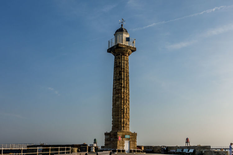 Whitby Whitby Harbour Whitby View Whitby North Yorkshire North Yorkshire North Yorkshire Coast Seaside Seaside Town Tourist Destination Coast Coastline Lighthouse Whitby Pier No People Architectural Column Tower Architecture Sky Built Structure Building Exterior Building Cloud - Sky Outdoors Monument Tall - High