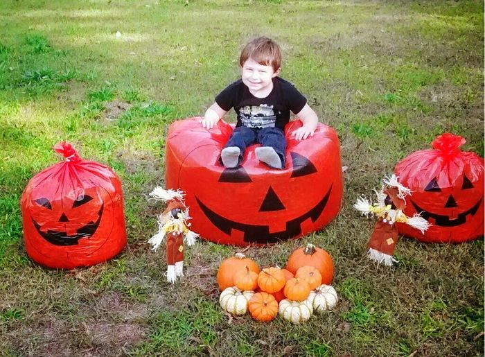 Pumpkin Grass Child Children Only Boys Halloween One Boy Only Looking At Camera Day Sitting Outdoors Smiling Full Length Portrait Looking At Camera Good Times EyeEm Selects EyeEmNewHere Burlington NC Babyphotography Backgrounds Naturephotography Photoshoot Photo Kids Perspectives On Nature