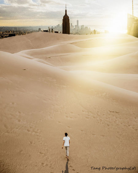 Abstract situation, i would love encounter ^^ Abstract Adult Architecture Beach Building Exterior Day Desert Leisure Activity Lifestyles One Person Outdoors People Photoshop Real People Sand Sky Sunset Travel Destinations