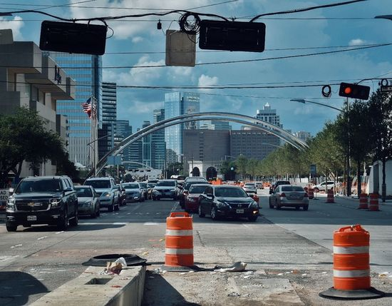 The hustle and bustle of Houston City Car Tree City Street City Life Traffic Sky Architecture Building Exterior Road Signal Green Light Land Vehicle Vehicle Moving