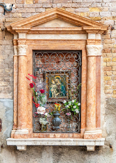 A Venetian window with a stone frame and Saint Mary painting, Venice, Italy Italy 🇮🇹 Mary And Jesus Venice Italy Architecture Art Baby Jesus Building Exterior Built Structure Close-up Day Decorated Window Flower History No People Outdoors Painting Saint Mary Stone Frame Travel Destinations Venetian Wall Window